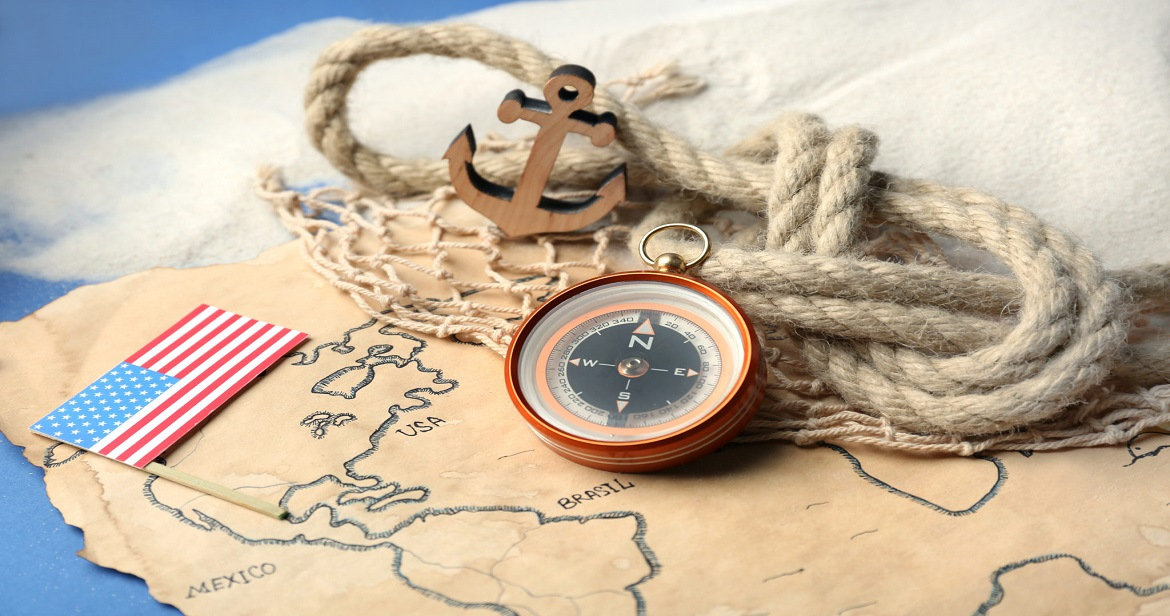USA flag rope and compass on old map Columbus Day